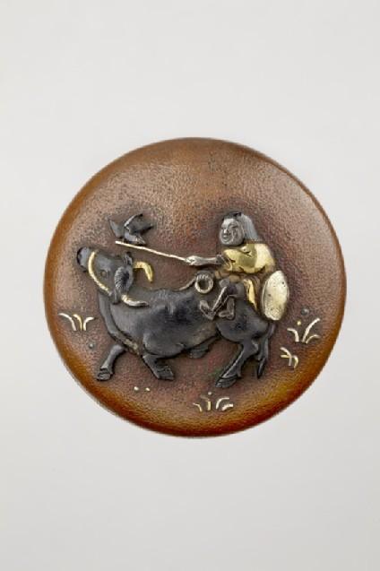 Manjū netsuke depicting a boy riding an ox