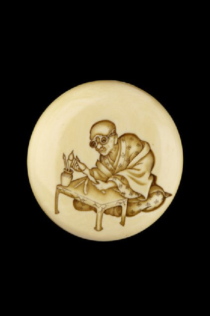 Manjū netsuke depicting a calligrapher
