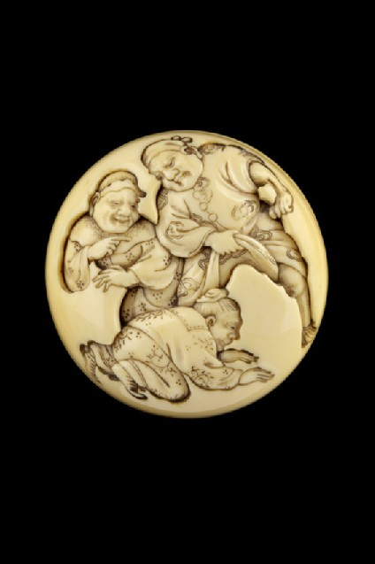 Manjū netsuke depicting Kanshin crawling through a brigands legs. Reverse, a third ruffian pointing at the unfortunate hero