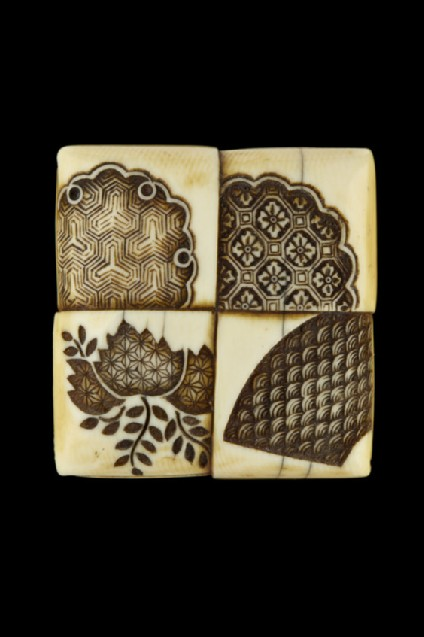 Manjū netsuke in the form of a folded chabin-shiki, or tea-pot mat, with textile designs