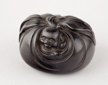 Manjū netsuke in the form of Hotei peering from his sack