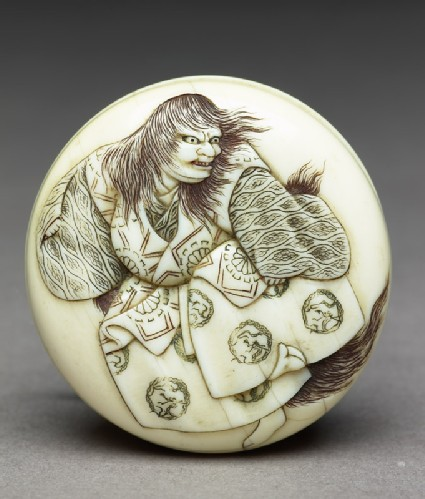 Manjū netsuke depicting the lion dance from the Nō play Shakkyō