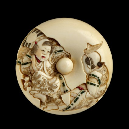 Manjū netsuke depicting a Sanbasō dancer and mask box bearer, with an uprooted pine sapling on the reverse