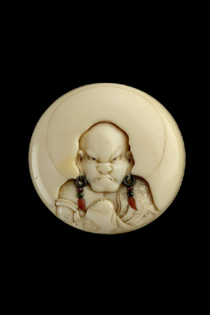 Manjū netsuke with a head and shoulders portrait of a rakan