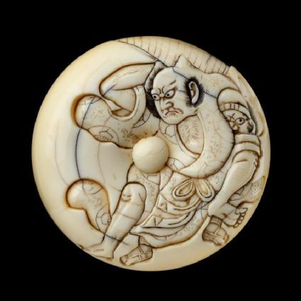 Manjū netsuke depicting Tadanobu defending himself with a gō board