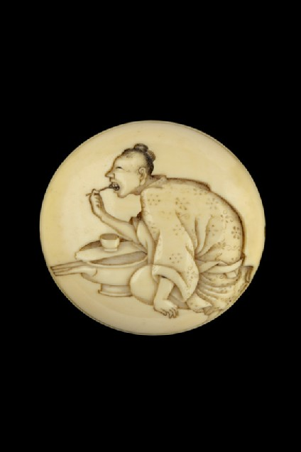 Manjū netsuke depicting a woman blackening her teeth