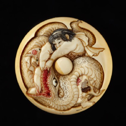 Manjū netsuke depicting Kintarō wrestling with a snake