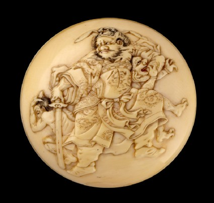 Manjū netsuke depicting Shōki the Demon Queller with two demons