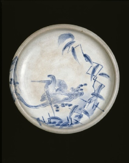 Dish with pheasants in a stream, beside reeds