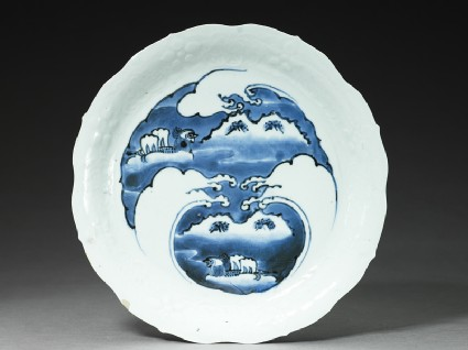 Dish with mandarin ducks amid waves