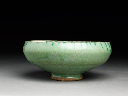 Bowl with green splashes