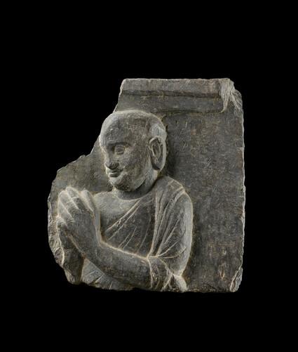 Relief fragment depicting a reverent monk