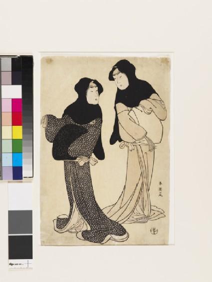 The actors Iwai Hanshirō IV and Segawa Kikujirō wearing black hoods