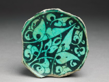Base fragment of a bowl with floral decoration