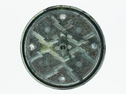 Ritual mirror with quatrefoils on geometric ground
