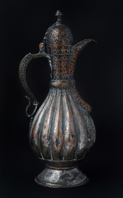 Ewer with scalloped body and engraved decoration