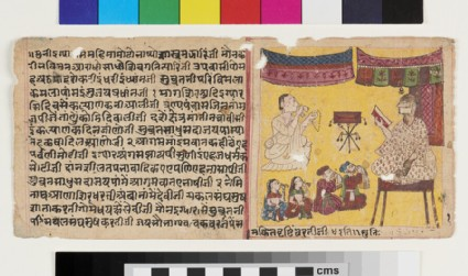Devotees visiting a Jain muni sitting on a raised seat