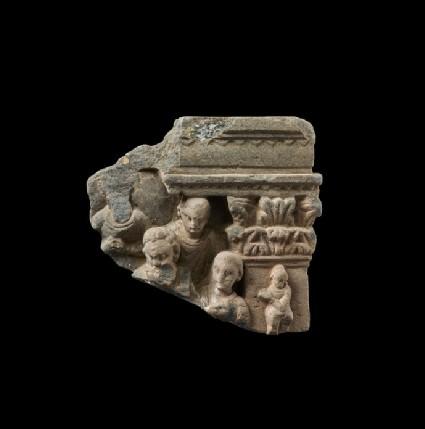 Relief fragment depicting four figures