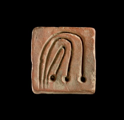 Squarish object incised with three curved lines and dots, probably a game counter, weight or sealing