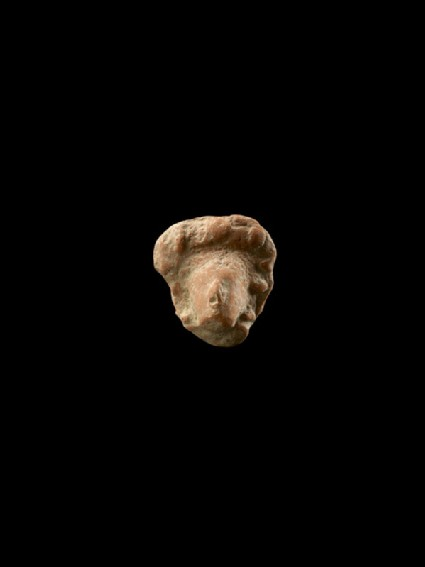 Wreathed head of a figure, probably a deity