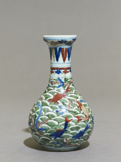 Wucai ware vase with fish amid waves