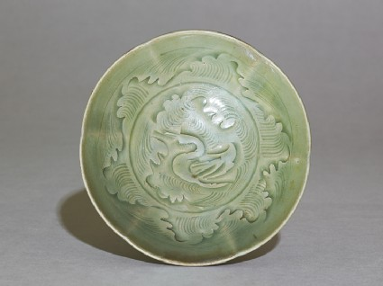 Greenware bowl with ducks amid waves