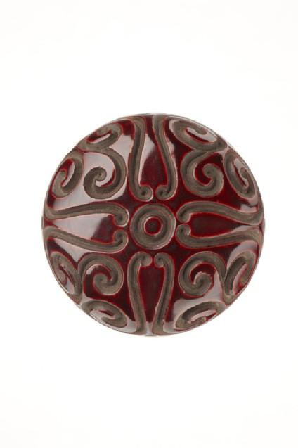 Manjū netsuke with geometric 'guri' patterning with the same pattern on the reverse
