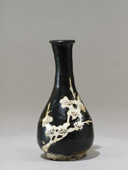 Black ware vase with prunus spray