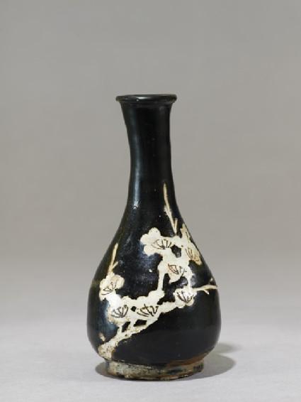 Black ware vase with prunus spray
