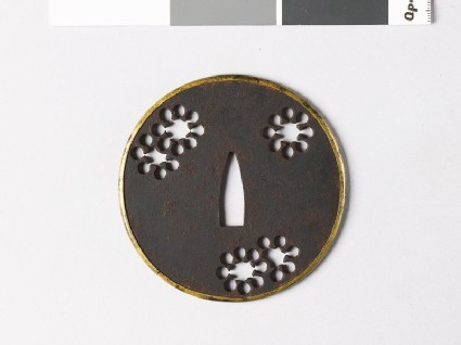 Round tsuba with 'nine-star' mon or snow