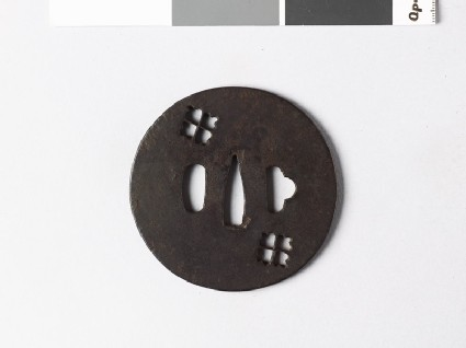 Lenticular tsuba with two karahana, or Chinese flowers