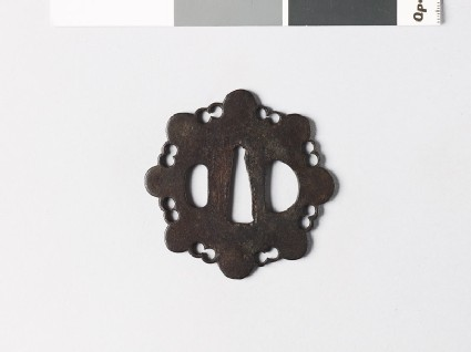 Tsuba in the form of a stylized flower