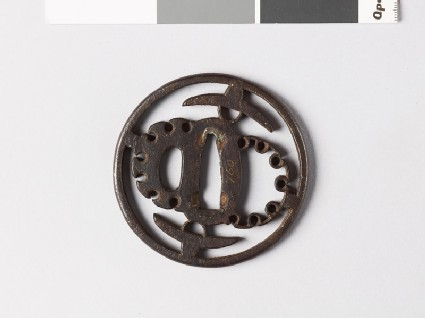 Round tsuba with hats and stylized snow heaps