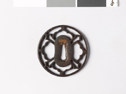 Tsuba with petals and sword-blades