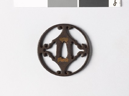 Round tsuba with voluted points