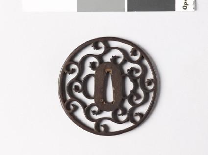 Round tsuba with karakusa, or scroll plant pattern