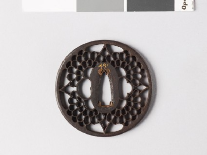 Round tsuba with four chrysanthemum flowers