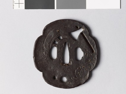 Mokkō-shaped tsuba with foliage, axe, and chariot wheel