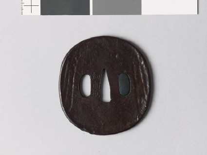 Lenticular tsuba with mitsudomoye, or three-comma shapes
