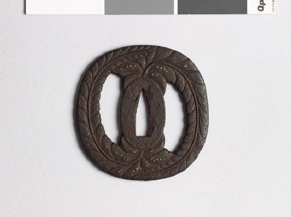 Tsuba with wisteria and dewdrops