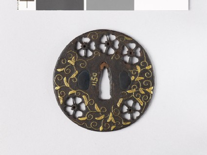 Round tsuba with cherry blossoms and karakusa, or scrolling plant pattern