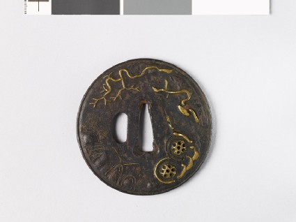 Round tsuba with landscape and plants