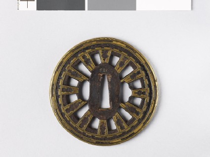 Round tsuba with wheel spokes and roped rim