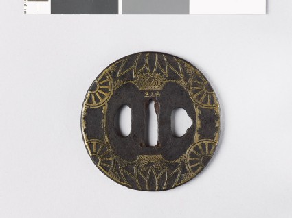 Round tsuba with half-wheels and bamboo leaves