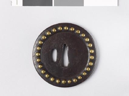 Round tsuba with brass studs