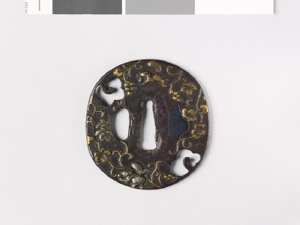 Tsuba with squirrels and a vine
