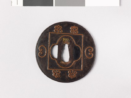 Lenticular tsuba with mokkō shape and C-scrolls