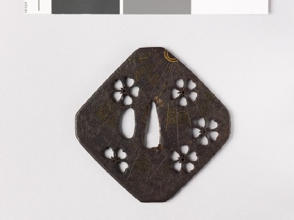 Tsuba with cherry blossoms and a cobweb