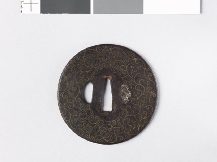 Round tsuba with scrolls and karigane, or flying geese