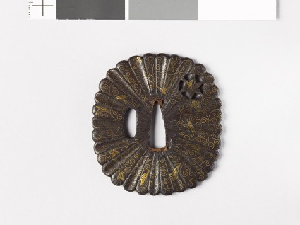 Tsuba with scrolling stems and heraldic cloves